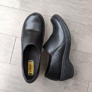 Clark's slip on black leather clogs size 7